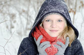Young blond woman with beanie and scarf winter wood portrait — Stock fotografie