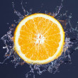 Orange splash — Stockfoto
