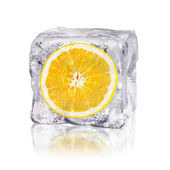 Orange in an ice cube — 图库照片