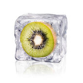 Kiwi in an ice cube — 图库照片