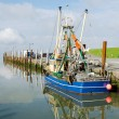 Stock Photo: Fishing cutter in harbour
