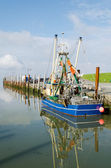 Fishing cutter in the harbour — Stock Photo