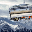 Stock Photo: Ski lift before mountain panorama