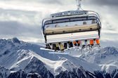 Ski lift before mountain panorama — Stock Photo