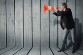 A man uses a warning cone as a megaphone — Stock Photo