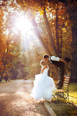 European bride and groom kissing in the park — Stok fotoğraf