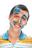 Portrait of a smiling young handsome guy with paint on his face — Stock Photo