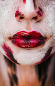 Lips of beautiful young girl with paint on his face — Stock Photo