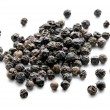 Stock Photo: Peppercorns isolated on white