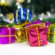 Christmas gift boxes with gold ribbon — Stock Photo #14172344