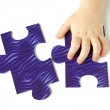 Stock Photo: Hhild hands with puzzle
