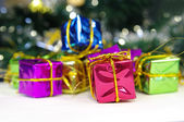Christmas gift boxes with gold ribbon — Stock Photo