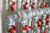 Pipes and valves for warm watter — Stock Photo