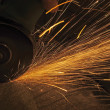 Metal sawing. Hot sparks at grinding steel material. — Stock Photo #31387133