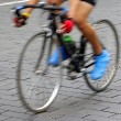 Motion blur abstract of a bike rider on the street — Stock Photo