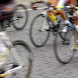 Motion blur abstract of a bike riders on the street — Stock Photo