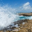 Stock Photo: Waves Crashing over Devil's Bridge Coastline Antigua