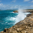 Stock Photo: Waves Crashing over Coastline at Devil's Bridge Antigua