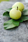 Apples and green leaves — Stock Photo