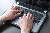 Businessman hands on laptop keyboard — Stock Photo