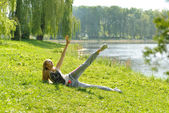 Beautiful girl stretches the body — Stock Photo