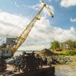 Floating crane digging sand on river side — Stock Video