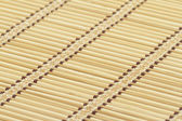 Bamboo mat as background — Stock Photo