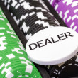 Set of poker chips and dealer button — Stock Photo