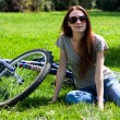 Woman with bike outdoors — Stock Photo