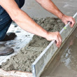 Plasterer concrete worker at floor work — Stock Photo