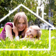 House construction, happy family - Stock Photo