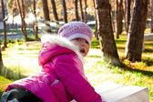 Girl in autumn sunny forest — Stock Photo