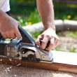 Carpenter with electric planes — Stockfoto