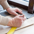 Laying laminate flooring — Stock Photo #38171301
