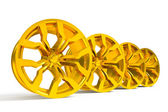 Car gold alloy wheel isolated over white — Foto Stock