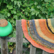 Stock Photo: Handmade rug and pot on fence.