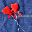 Stock Photo: Hearts on jeans.