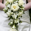 Bride holding a weddingbouquet — Stock Photo #12852684
