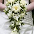 Bride holding a weddingbouquet — Stock Photo