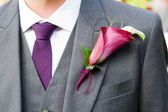 Groom wearing a lily buttonhole — Stock Photo