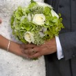Bride and groom with wedding bouquet — Stock Photo