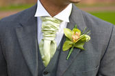 Groom with orchid buttonhole at wedding — Stock Photo