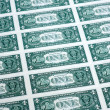 Many one dollar bills side by side — Stock Photo #15347479