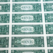 Many one dollar bills side by side — Stock Photo #15347483