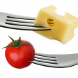 Stock Photo: Tomato and cheese on fork against white background