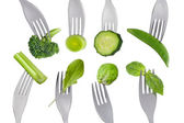 Healthy raw green food selection on white — Stock Photo