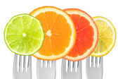 Citrus fruit on forks isolated on white — Stock Photo