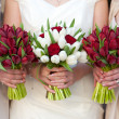 Red and white tulip and rose wedding bouquets — Stock Photo