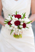 Red rose and white tulip wedding bouquet — Stock Photo
