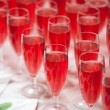 Stock Photo: Pink champagne in flutes